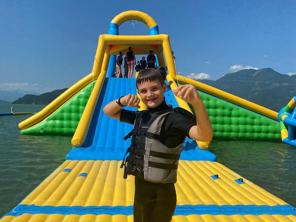 Kids at harrison lake inflatable water park.