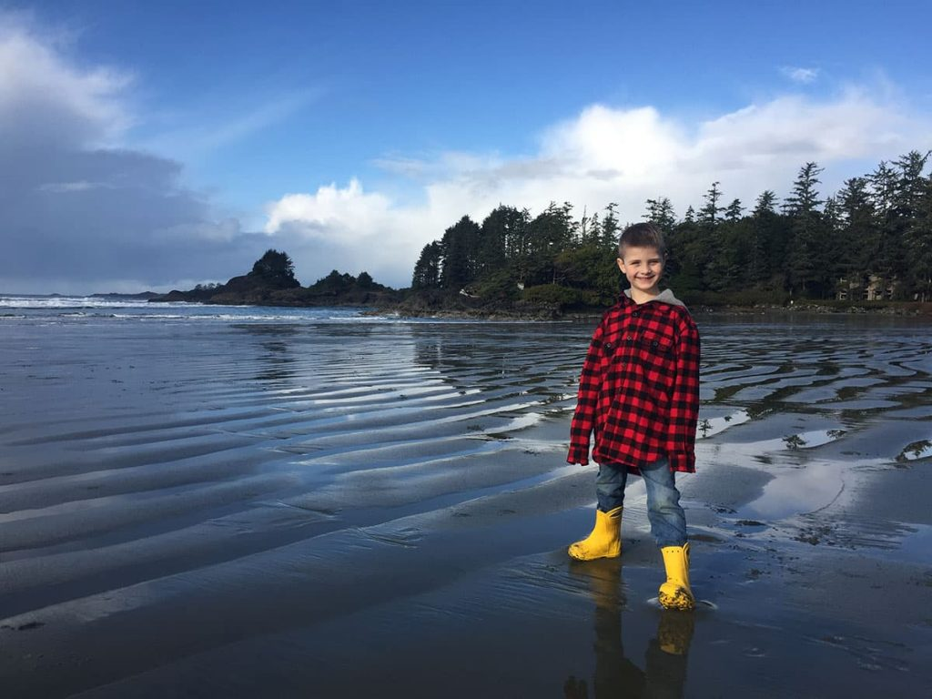 Tofino - Cox Bay Beach with kids in boots.