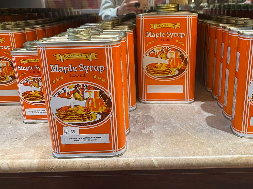 Maple syrup souvenirs in containers.